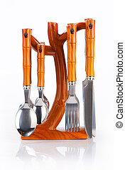 Kitchen utensil set standing against white background