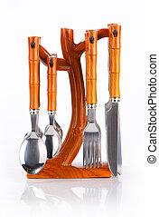 Kitchen utensil set standing against white background