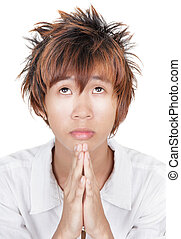 Praying Korean teen portrait - Closeup portrait of angelic...