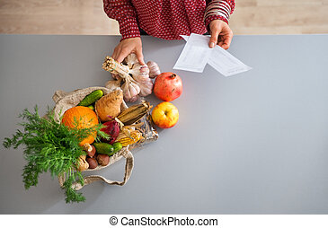 Closeup from above of fall fruits and vegetables in kitchen