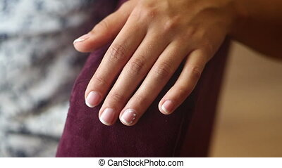 brides hand with manicure closeup