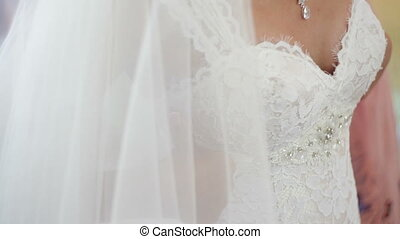 Brides wear a necklace around neck