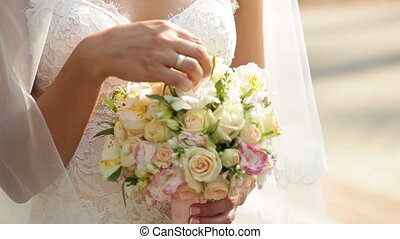 happy bride holding a bouquet