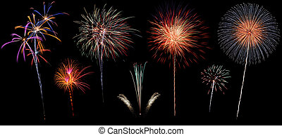 Variety of colorful fireworks isolated on black background -...