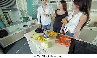 Three friends gather to drink orange fresh