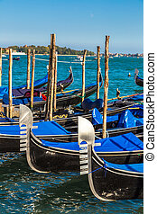 Gondolas in Venice, Italy - Gondolas in a summer day in...