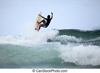 surfer in ocean - Young men - the surfer in ocean. Bali....
