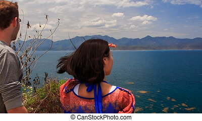 guy girl admire scenery of seascape watch sea and island