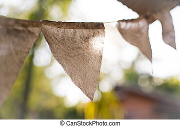 Colorful bunting flags hanging on tree with retro and...