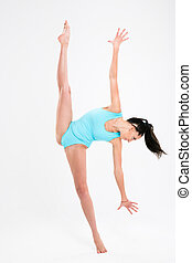 Beautiful woman doing acrobatic stunt isolated on a white...