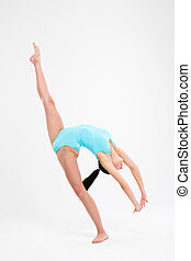 Girl doing acrobatic stunt - Young girl doing acrobatic...