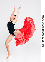 Young woman doing acrobatic stunt isolated on a white...