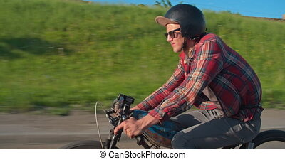 Retro Moped Rider - Side view of young rider speeding along...