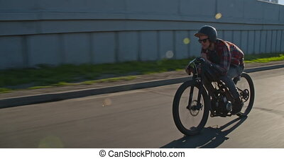 Skillful Rider - Skillful rider moving down road on his...