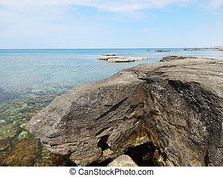 Caspian Sea. - Water splashes around the stone. Caspian Sea....