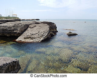 Caspian Sea - Water splashes around the stone Caspian Sea...