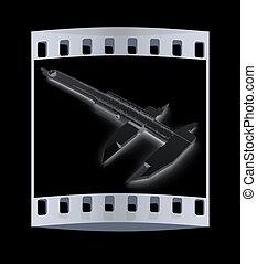 Vernier caliper The film strip - Vernier caliper on a black...