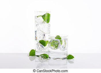 fizzy water with mint and ice - glasses of fizzy water with...