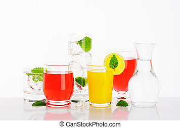 summer drinks - Glasses of water and fruit juices with mint...