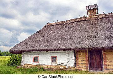 Ukrainian hut thatched sloping field near - Image Ukrainian...