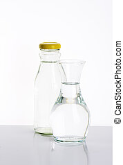 water - glass bottle and carafe of fresh water