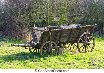 old wooden cart - old wooden horse drawn wagon standing on...