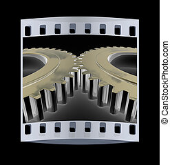 Gear set The film strip - Gear set on a black background The...