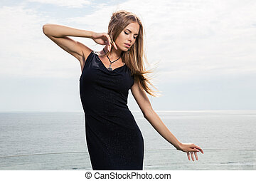 Fashion woman posing outdoors