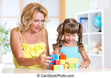 mom with her daughter child play together