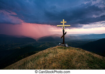 Cross over the valley on a background of dramatic sky with storm clouds