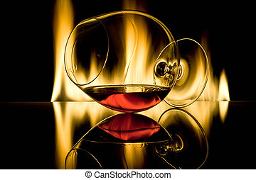 Glass with alcohol against fire