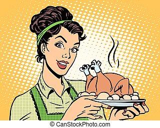 woman hot dish bird potatoes - A woman with a hot dish bird...