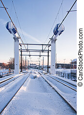 Train lifting bridge in the snow on early winter morning -...
