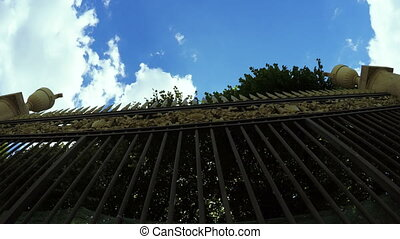 High Forged fence - Camera shoots from below wrought iron...