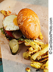 Fried egg burger above view - Fried egg burger served with...