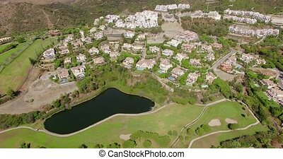 Aerial Flight Over Houses and Golf Fields in Spanish...