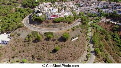 Aerial Flight Over Houses on Hill in Spanish Andalucia