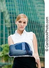 Businesswoman With Injured Arm - A young businesswoman with...