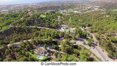 Aerial Flight Over Houses and Forrest in Mountains Andalucia...