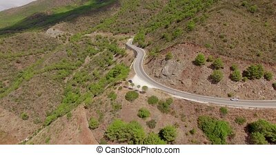 Aerial. A View From Flying Drone to Curvy Road in Spanish...