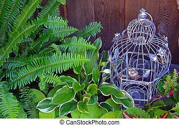 Decorative bird cage in green garden - Decorative bird cage...