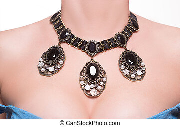 necklace on the neck - a beautiful necklace on female breast...
