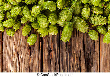 Fresh green hops on wooden desk - Fresh green hops on a...