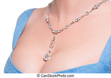 necklace on the neck - a beautiful necklace on female...