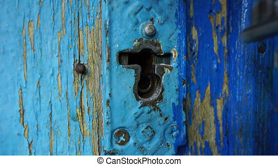 man opens keyhole key - the man opens keyhole key