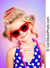stylish sunglasses - Fashionable little girl in her mother's...