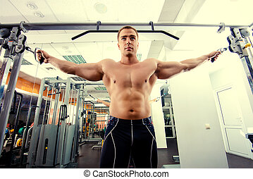 work out - Athletic man working out with weight training...