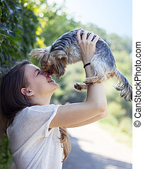 Beautiful woman to kiss the dog