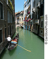 Gondolier at work in Venice - Gondolier paddling his gondola...