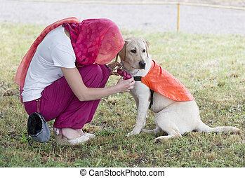 Trainer with labrador retriever guide dog - A trainer is...